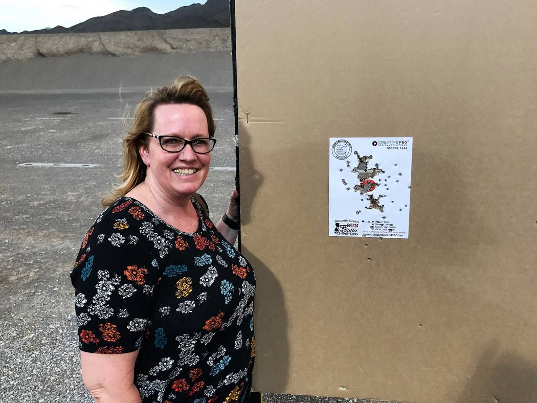 Becky Smith, a Las Vegas paralegal, celebrates the achievement of her goal to shoot the red dot out of the middle of her pistol target during a women's night out at the Clark County Shooting Compl ...