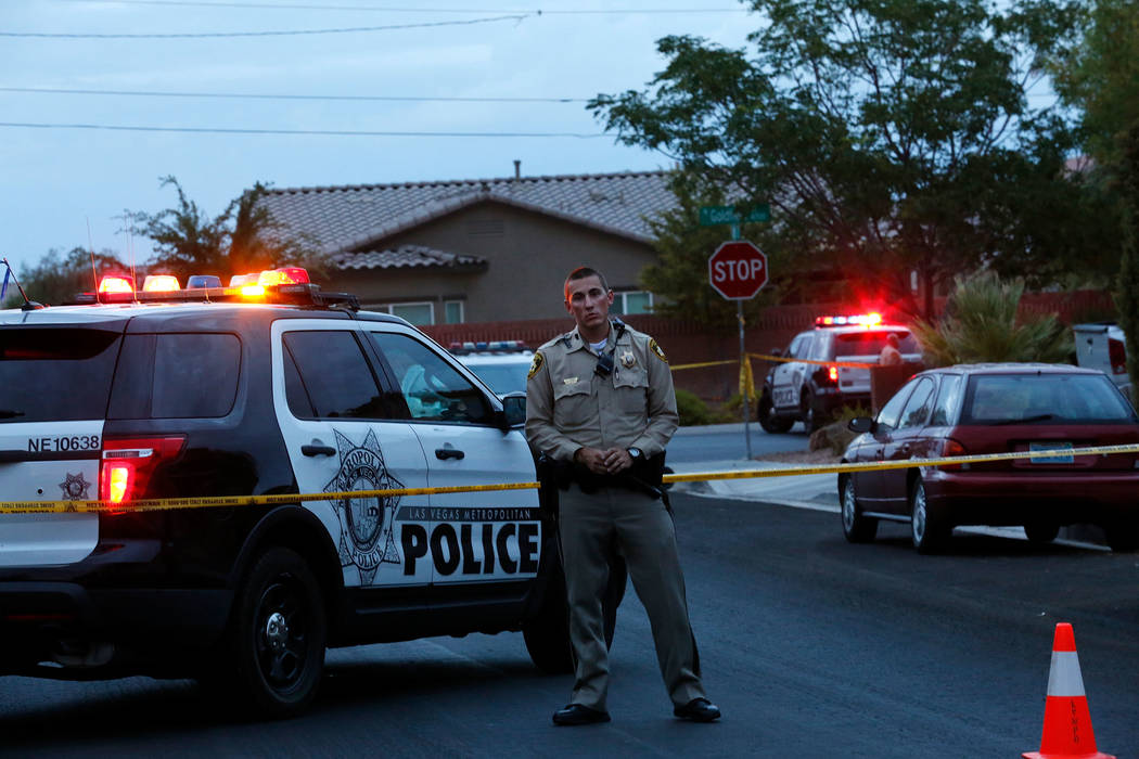 A police officer blocks a street near North Goldfield Street in North Las Vegas, where police investigate an officer-involved shooting, Monday, July 24, 2017. According to police, two people have  ...