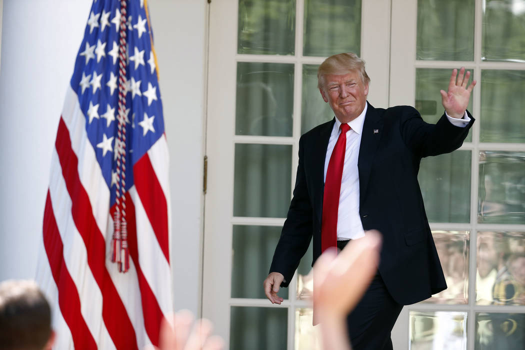 President Donald Trump waves as he leaves the Rose Garden of the White House in Washington, Wednesday, July 26, 2017, after speaking during an event with the American Legion Boys Nation and the Am ...