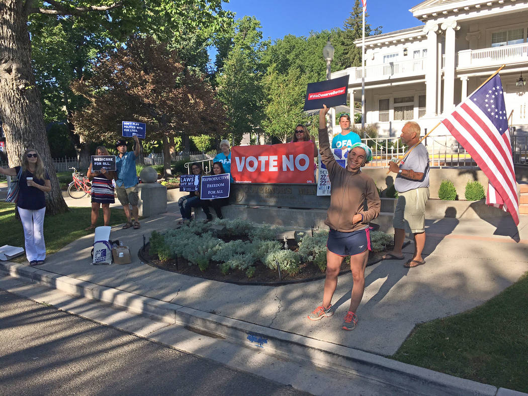 About a dozen people gathered outside the Governor's Mansion in Carson City on Wednesday, July 26, 2017, to protest changes to Obamacare being considered in the U.S. Senate. Sean Whaley/Las Vega ...
