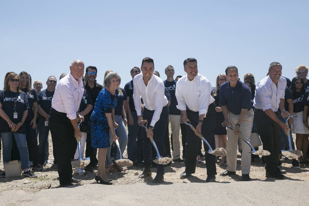 From left: Kevin T. Orrock, Summerlin president of the Howard Huges Corp., Susan Brager, Clark County commissioner, Matt Wilson, managing director of the Americas for Aristocrat, Gov. Brian Sandov ...