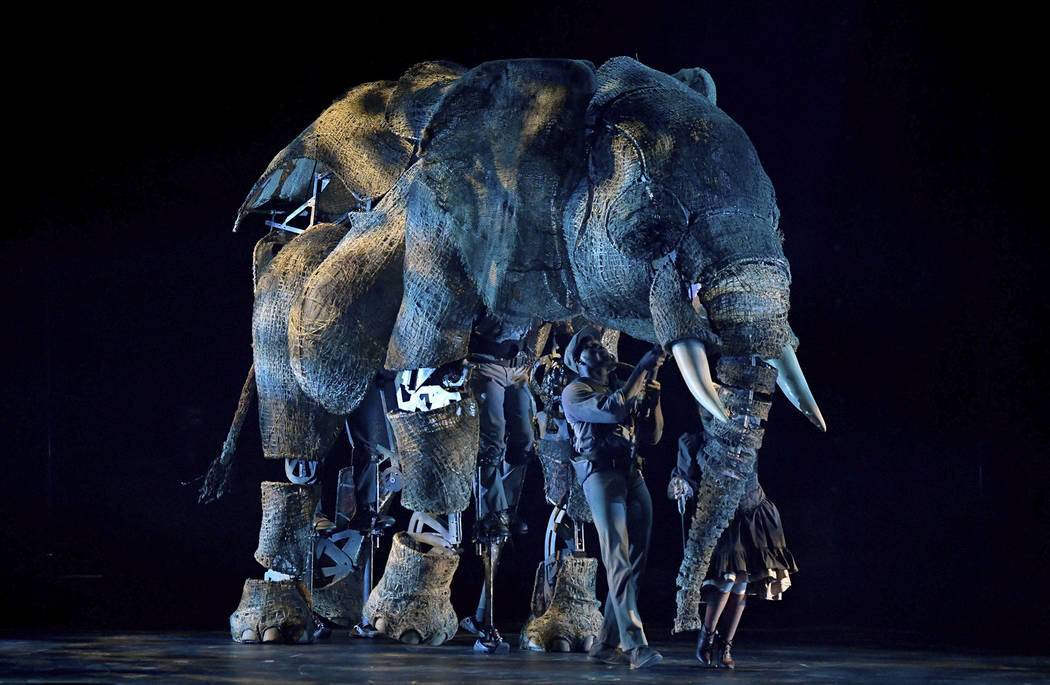 """Puppeteers perform with an elephant puppet named Queenie during the opening night of """"Circus 1903"""" at Paris Las Vegas.  Ethan Miller Getty Images"""