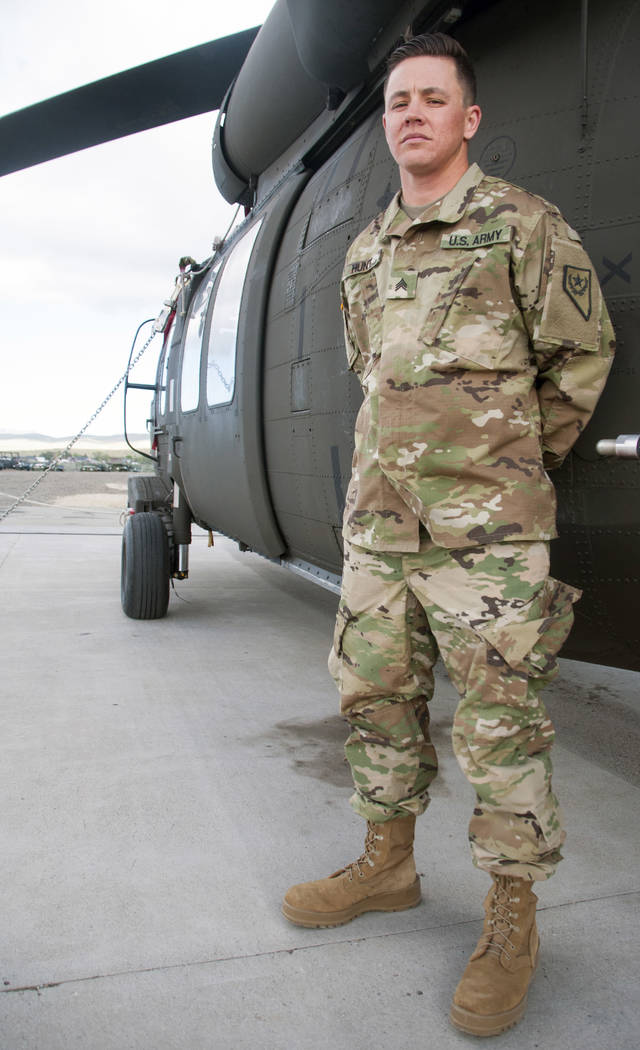 Nevada Army National Guard Sgt. Sam Hunt, an electrician with G Company, 2/238th General Support Aviation Battalion poses for a photo on the flight line at the Army Aviation Support Facility in St ...