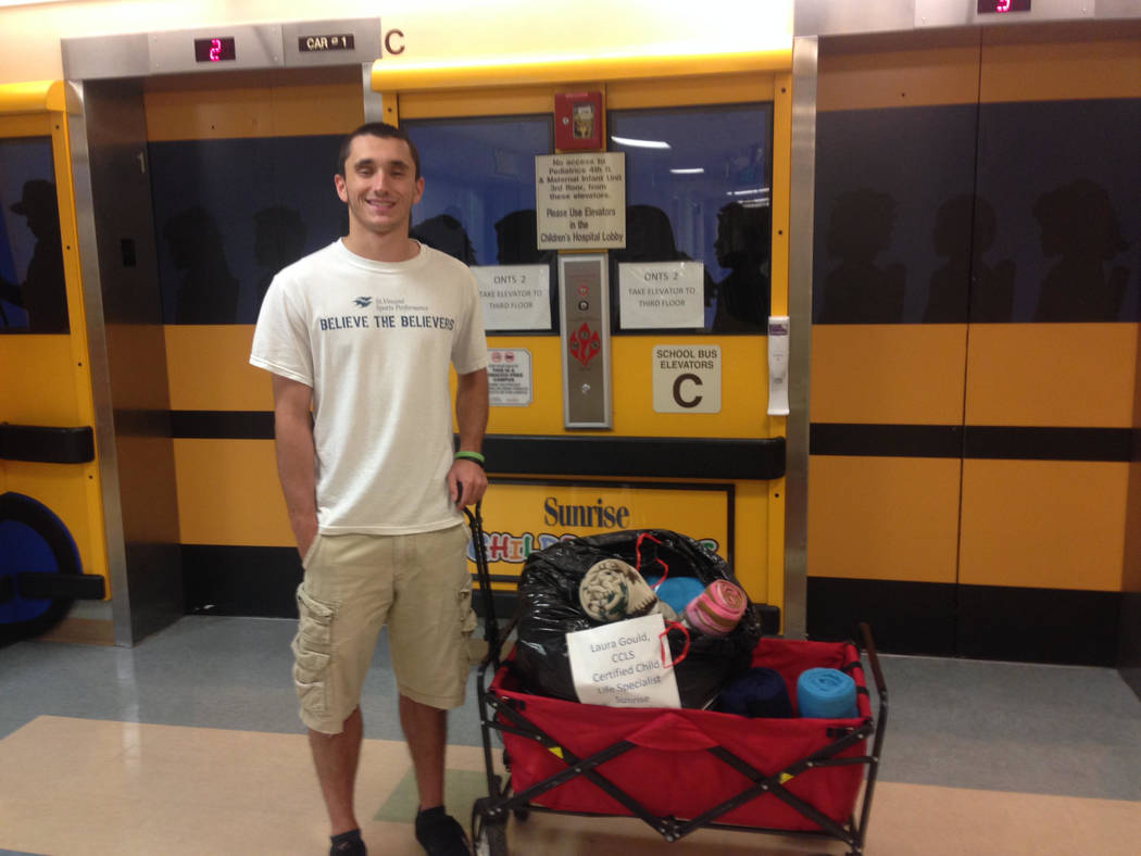Michael Spada, now 21, delivers fleece blankets in this undated photo from 2015 to Sunrise Hospital's childhood oncology unit. He was once a patient there as he was battling Burkitt lymphoma, a fo ...