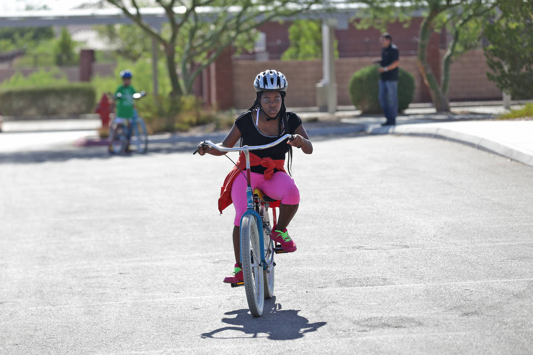 Chantae Hill rides a bike at a bicycle camp for adults and children with disabilities on Thursday, July 27, 2017, at Opportunity Village's Engelstad Campus. Rachel Aston Las Vegas Review-Journal @ ...