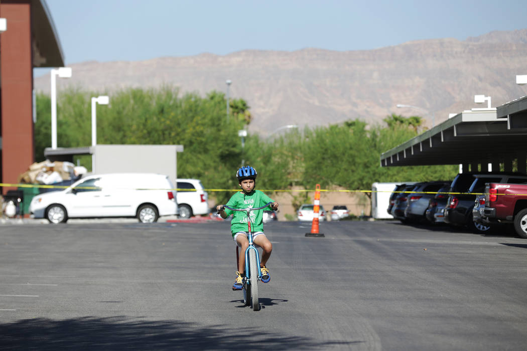 Alessandro Briceno, 10, rides a bike at a bicycle camp for adults and children with disabilities on Thursday, July 27, 2017, at Opportunity Village's Engelstad Campus. Rachel Aston Las Vegas Revie ...