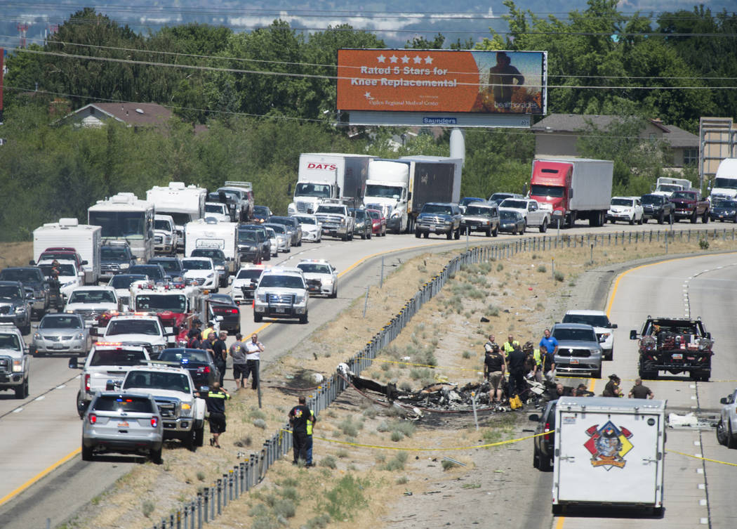 Four people died when their small plane crashed in the middle of I-15 near Riverdale, Utah, Wednesday, July 26, 2017. The crash closed the freeway to northbound traffic. (Rick Egan/The Salt Lake T ...