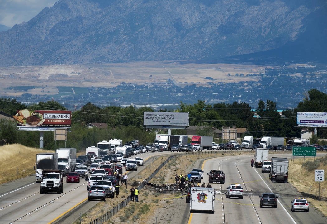 Four people died when their small plane crashed in the middle of I-15 near Riverdale, Utah,  Wednesday, July 26, 2017. The crash closed the freeway to northbound traffic. (Rick Egan/The Salt Lake  ...