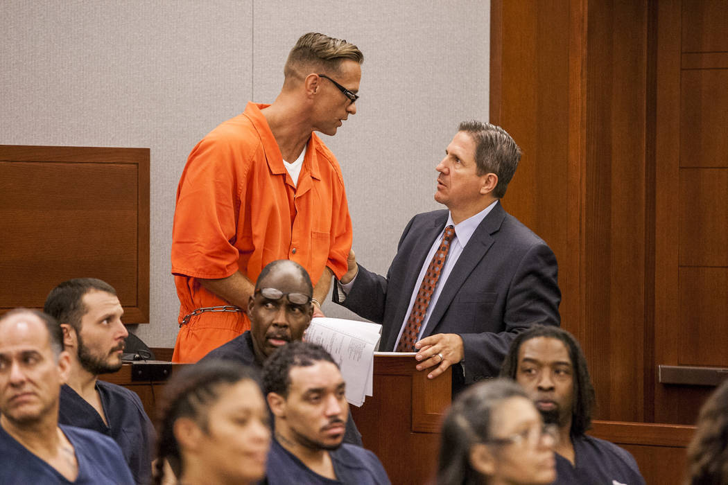 Two-time killer Scott Dozier talks with his attorney at the Regional Justice Center on Thursday, July 27, 2017. Dozier was advised by his attorney and others to seek an appellate trial, but wished ...