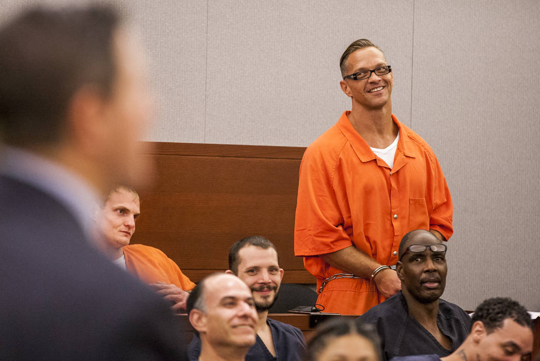 Two-time killer Scott Dozier smiles after cracking a joke during his hearing at the Regional Justice Center on Thursday, July 27, 2017. Dozier was advised by his attorney and others to seek an app ...