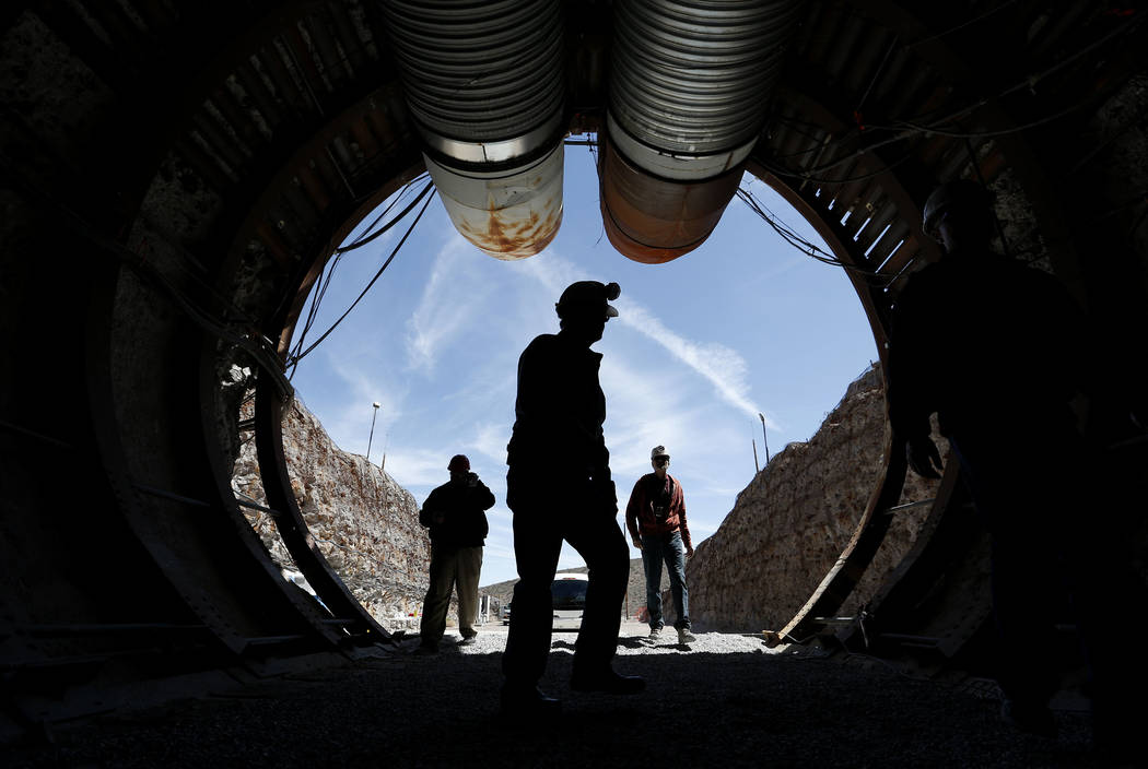 In this April 9, 2015, file photo, people walk into the south portal of Yucca Mountain during a congressional tour of the proposed radioactive waste dump near Mercury, Nev., 90 miles northwest of  ...