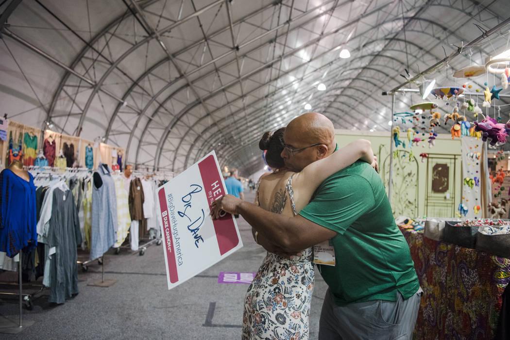 """Big Dave"" Sylvester gives Amanda Canepa a hug at Las Vegas Gift Show at Las Vegas Market on Sunday, July 30, 2017, in Las Vegas. Morgan Lieberman Las Vegas Review-Journal"