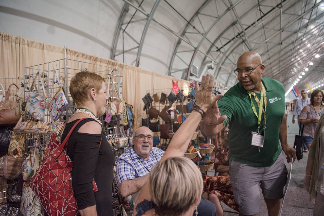 """Big Dave"" Sylvester, right, gives a group a series of high-fives at Las Vegas Gift Show at Las Vegas Market on Sunday, July 30, 2017, in Las Vegas. Morgan Lieberman Las Vegas Review-Journal"