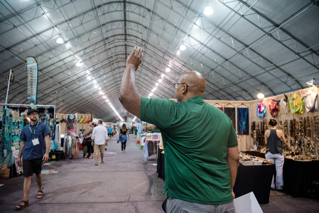 """Big Dave"" Sylvester, center, approaches Matthew Cunningham at Las Vegas Gift Show at Las Vegas Market on Sunday, July 30, 2017, in Las Vegas. Morgan Lieberman Las Vegas Review-J ..."