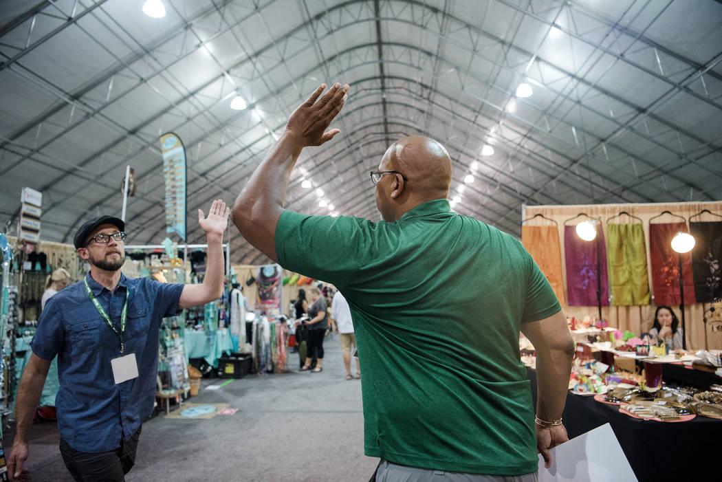 """Big Dave"" Sylvester, right, approaches Matthew Cunningham at Las Vegas Gift Show at Las Vegas Market on Sunday, July 30, 2017, in Las Vegas. Morgan Lieberman Las Vegas Review-Jo ..."