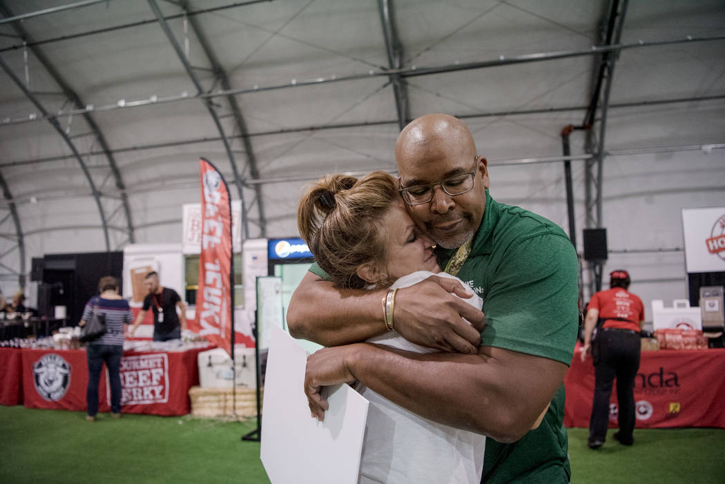 """Big Dave"" Sylvester embraces Donna Clark at Las Vegas Gift Show at Las Vegas Market on Sunday, July 30, 2017, in Las Vegas. Morgan Lieberman Las Vegas Review-Journal"