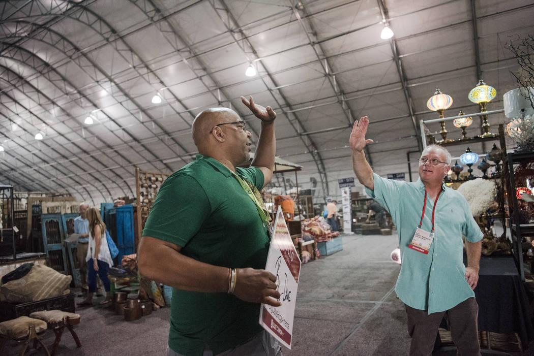 """Big Dave"" Sylvester, left, high-fives Robert Martinsen at Las Vegas Gift Show at Las Vegas Market on Sunday, July 30, 2017, in Las Vegas. Morgan Lieberman Las Vegas Review-Journal"