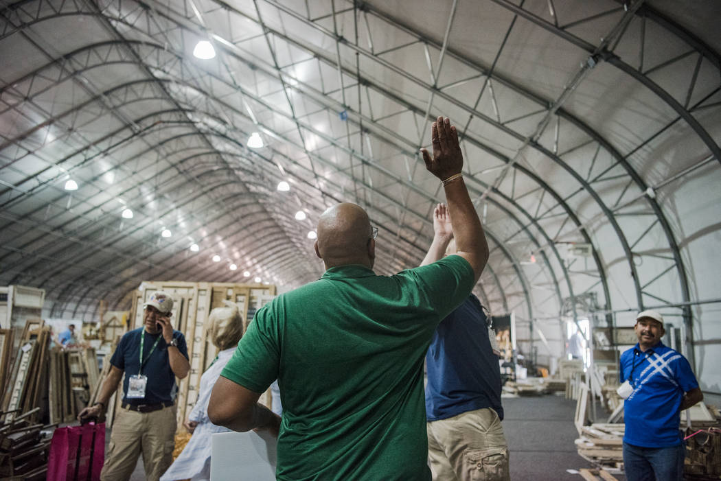 """Big Dave"" Sylvester, center, high-fives bystanders at Las Vegas Gift Show at Las Vegas Market on Sunday, July 30, 2017, in Las Vegas. Morgan Lieberman Las Vegas Review-Journal"