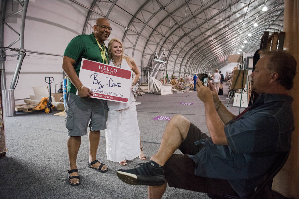 """Big Dave"" Sylvester, left, takes a photo with Michele Lony at Las Vegas Gift Show at Las Vegas Market on Sunday, July 30, 2017, in Las Vegas. Morgan Lieberman Las Vegas Review-J ..."