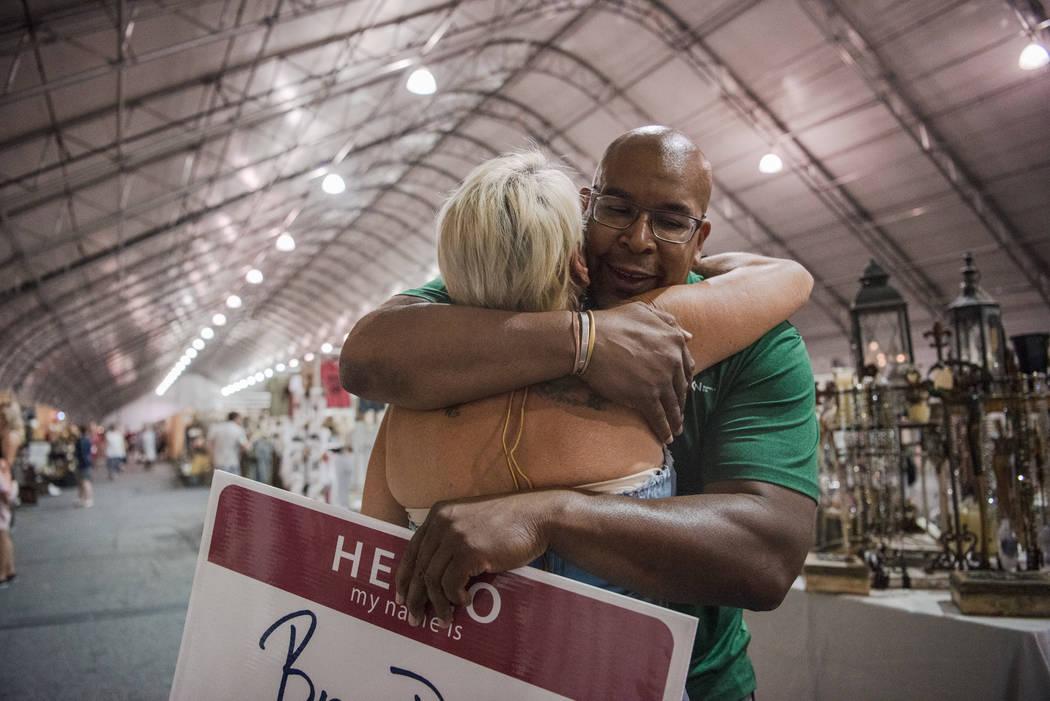 """Big Dave"" Sylvester gives Darlah Mulloy a hug at Las Vegas Gift Show at Las Vegas Market on Sunday, July 30, 2017, in Las Vegas. Morgan Lieberman Las Vegas Review-Journal"