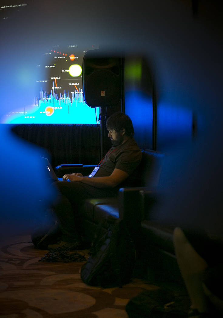A Black Hat tech associate works in the network operating center (NOC) during the Black Hat information security conference at Mandalay Bay, Wednesday, July 26, 2017, In Las Vegas. Richard Brian L ...