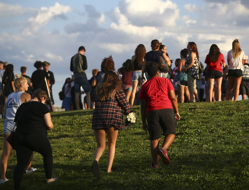 People gather for a vigil in memory of Haylei Hughes, a former Cimarron-Memorial student-athlete, who died in a hiking accident in Wash., at Kellogg Zaher Sports Complex in Las Vegas on Thursday,  ...