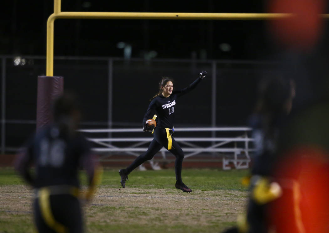 Cimarron-Memorial's Haylei Hughes (18) celebrates after scoring a touchdown on an interception during the Class 4A state championship flag football game at Cimarron-Memorial High School in Henders ...