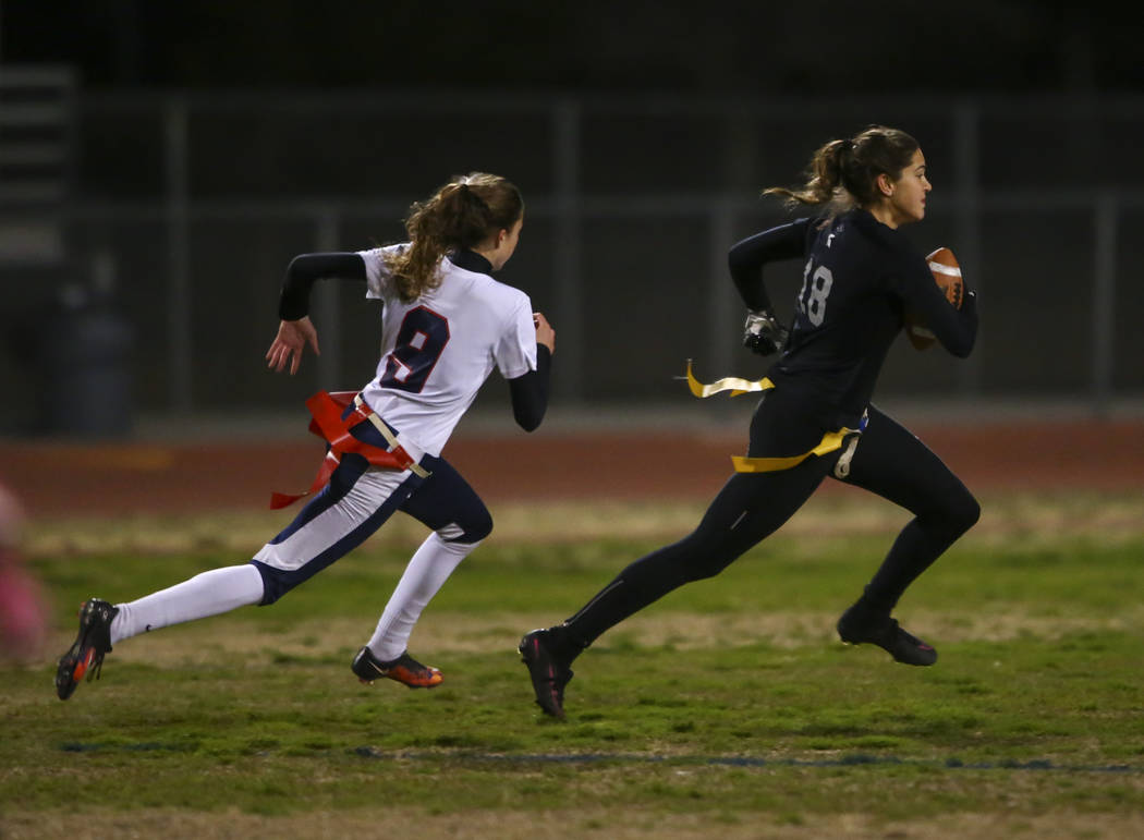 Cimarron-Memorial's Haylei Hughes (18) runs for the end zone past Coronado's Caitlin Shannon (9) to score a touchdown on an interception during the Class 4A state championship flag football game a ...