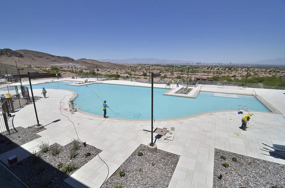 Workers get the pool ready for the opening of the new Ascaya clubhouse. (Bill Hughes Real Estate Millions)