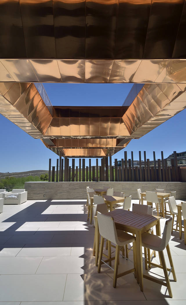 The Ascaya clubhouse features a copper-accented porte-cochere. (Bill Hughes Real Estate Millions)