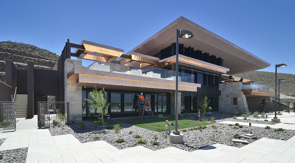 A worker puts the final touches on the Ascaya clubhouse which opened to residents July 4. (Bill Hughes Real Estate Millions)