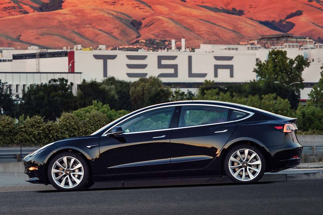This undated image provided by Tesla Motors shows the Tesla Model 3 sedan. The electric car company's newest vehicle, the Model 3, which set to go to its first 30 customers Friday, July 28, ...