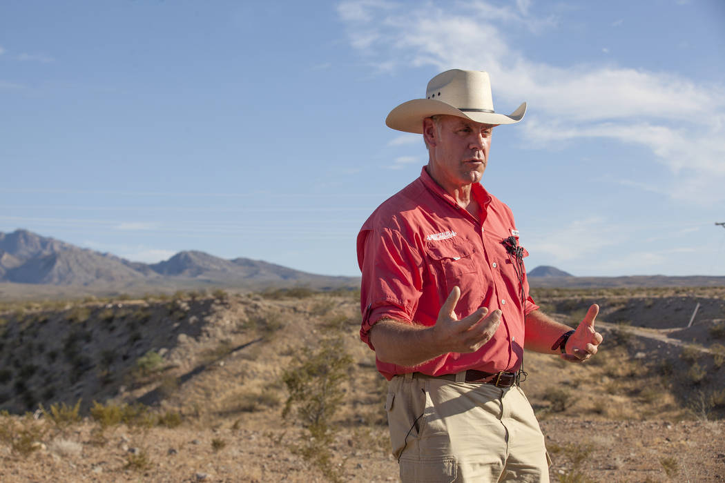 Interior Secretary Ryan Zinke talks to the media on Sunday, July 30, 2017, outside a private home in Bunkerville. Zinke is in the area to discuss the review of Nevada's Gold Butte and the Basin an ...