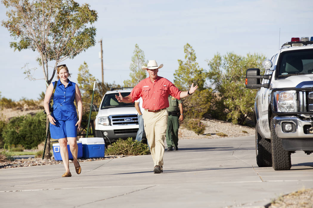 Interior Secretary Ryan Zinke approaches the media on Sunday, July 30, 2017, outside a private home in Bunkerville. Zinke is in the area to discuss the review of Nevada's Gold Butte and the Basin  ...