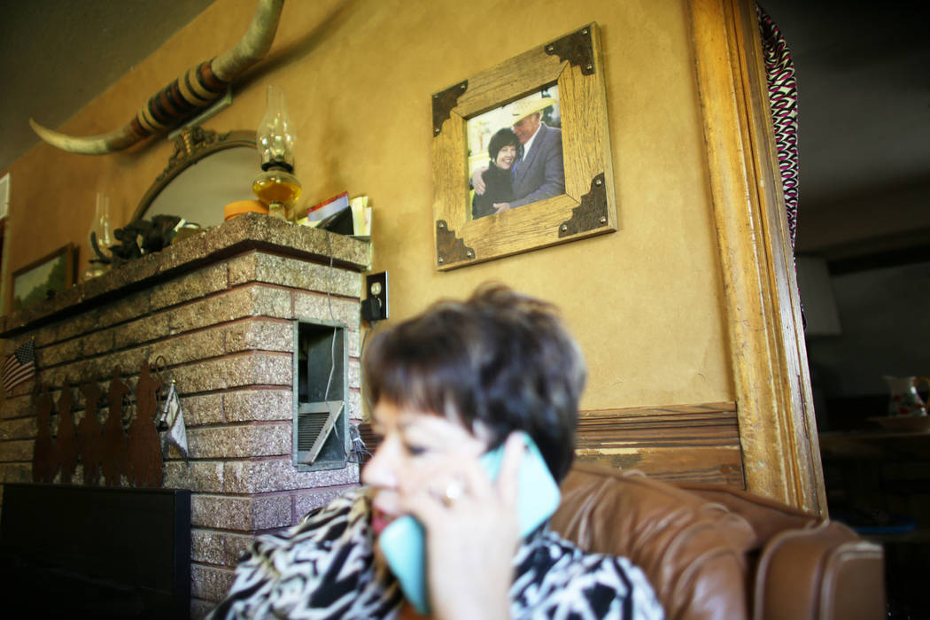 Carol Bundy speaks to Cliven Bundy on the phone at her ranch on Sunday, July 30, 2017, near Bunkerville. A photo of her and Cliven Bundy is on the wall. Interior Secretary Ryan Zinke is in the are ...