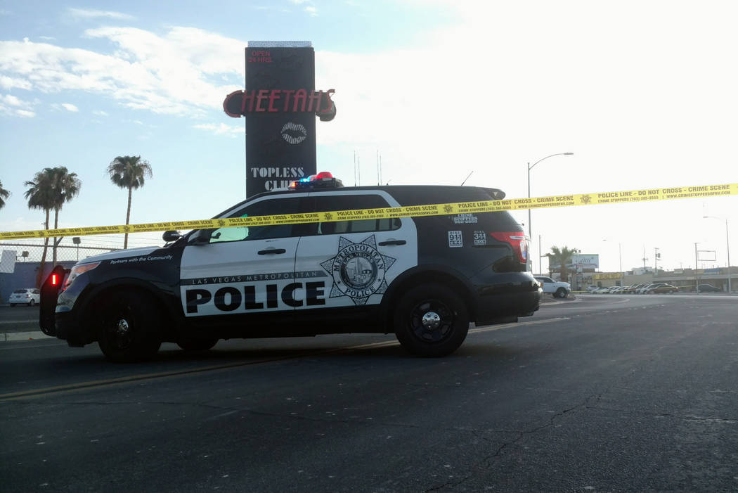 A Metropolitan Police Department patrol vehicle sits behind police tape Saturday morning, blocking off the 1800 block of Western Avenue where an officer fired a weapon but did not injure anyone. M ...