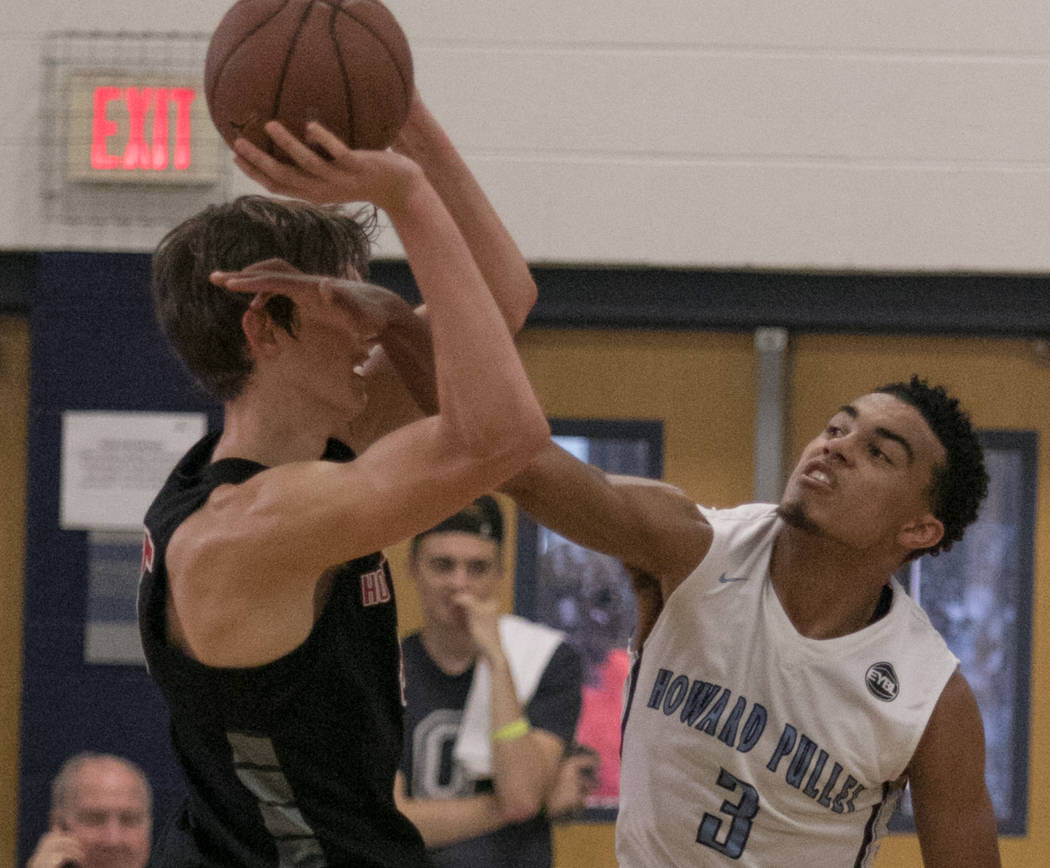Howard Pulley Panthers point guard Tre Jones attempts the basket against Houston Hoops forward Matthew Mayer at Spring Valley High School on Friday, July 28, 2017, in Las Vegas. Morgan Lieberman L ...