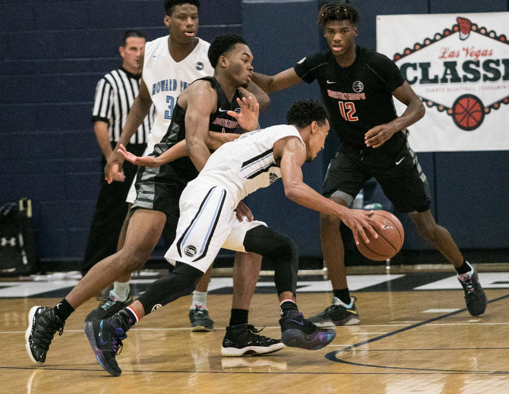 Howard Pulley Panthers point guard Tre Jones against Houston Hoops forward Tyreek Smith and guard Ja'Vonte Smart at Spring Valley High School on Friday, July 28, 2017, in Las Vegas. Morgan Lieberm ...