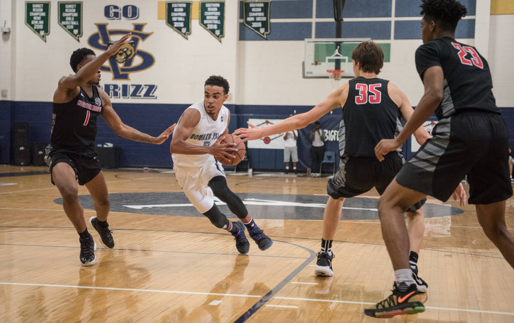 Howard Pulley Panthers point guard Tre Jones against Houston Hoops guard Ja'Vonte Smart, forward Matthew Mayer, and forward Jacobi Gordon at Spring Valley High School on Friday, July 28, 2017, in  ...
