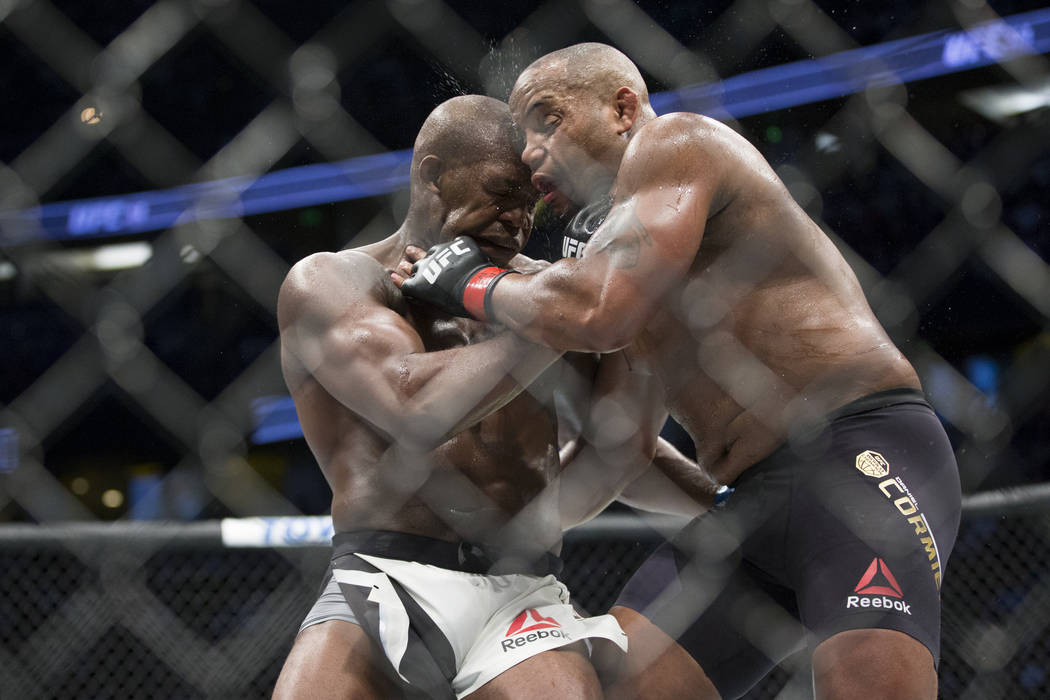 Jon Jones, left, battles Daniel Cormier in the light heavyweight title bout during UFC 214 at the Honda Center in Anaheim, Calif., on Saturday, July 29, 2017. Jones won by knockout. Erik Verduzco  ...