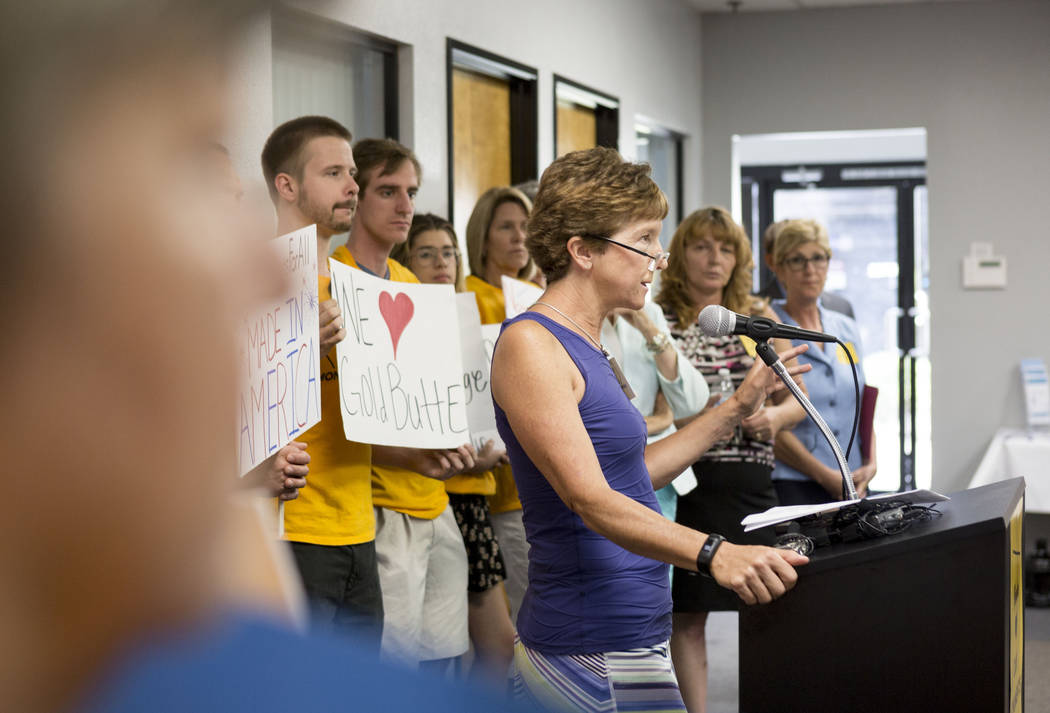 Terri Rylander, community member of Friends of Gold Butte, center, speaks during a news conference about Secretary Zinke's shortened visit to Nevada at a Battle Born Progress office in Las Vegas,  ...
