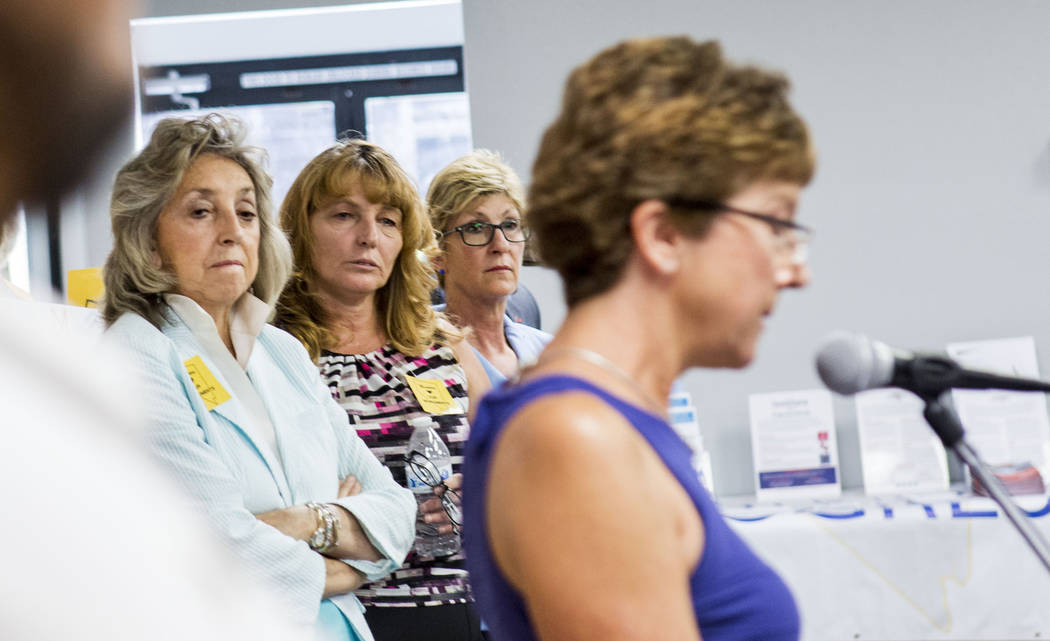 Rep. Dina Titus, D-Nev., from left, Commissioner  Marilyn Kirkpatrick and Commissioner Chris Giunchigliani listen to Terri Rylander, community member of Friends of Gold Butte, foreground, during a ...