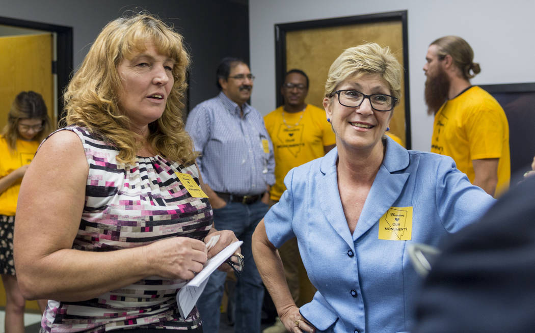 Commissioner Marilyn Kirkpatrick, left, and Commissioner Chris Giunchigliani talk during a news conference about Secretary Zinke's shortened visit to Nevada at a Battle Born Progress office in Las ...
