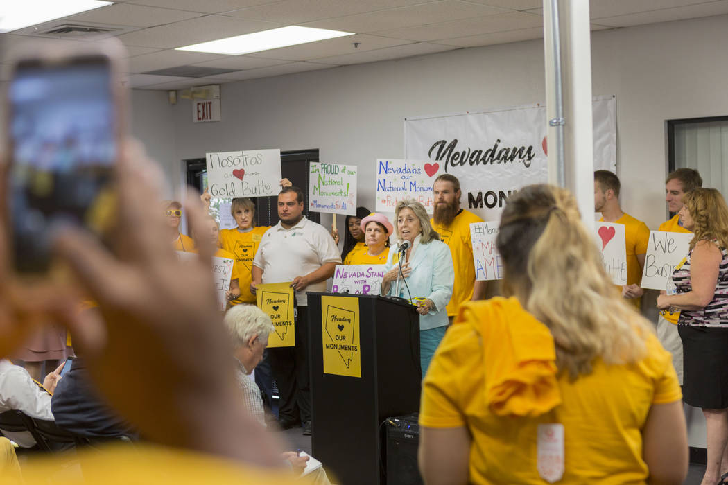 Rep. Dina Titus, D-Nev., center, speaks during a news conference about Secretary Zinke's shortened visit to Nevada, at a Battle Born Progress office in Las Vegas, Monday, July 31, 2017. Elizabeth  ...