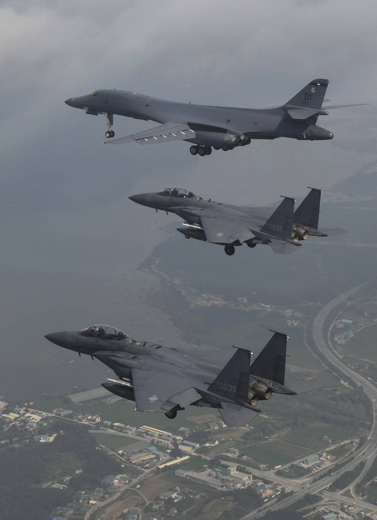 A U.S. Air Force B-1B bomber, top, flies with South Korean fighter jets F-15K over Osan Air Base in Pyeongtaek, South Korea, Sunday, July 30, 2017. (South Korea Defense Ministry via AP)