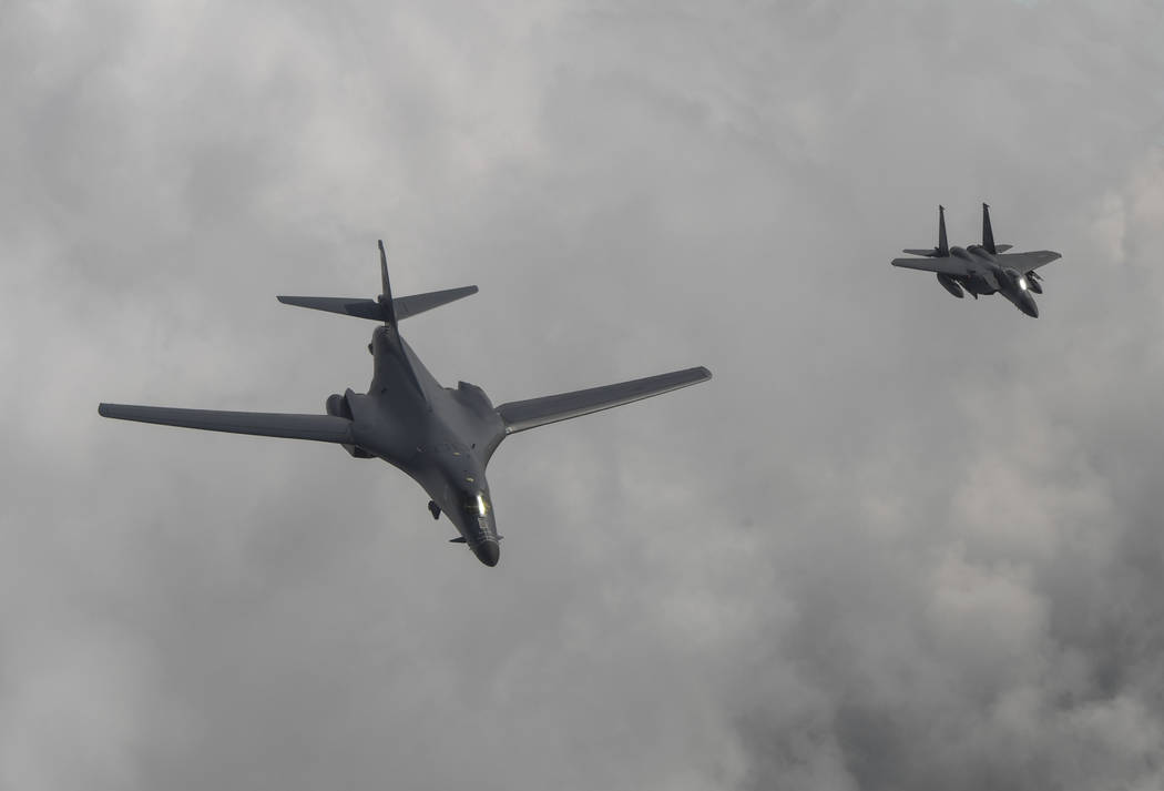 A U.S. Air Force B-1B bomber, left, flies with a South Korean fighter jet F-15K over the Korean Peninsula, South Korea, Sunday, July 30, 2017. The United States flew two supersonic bombers over th ...