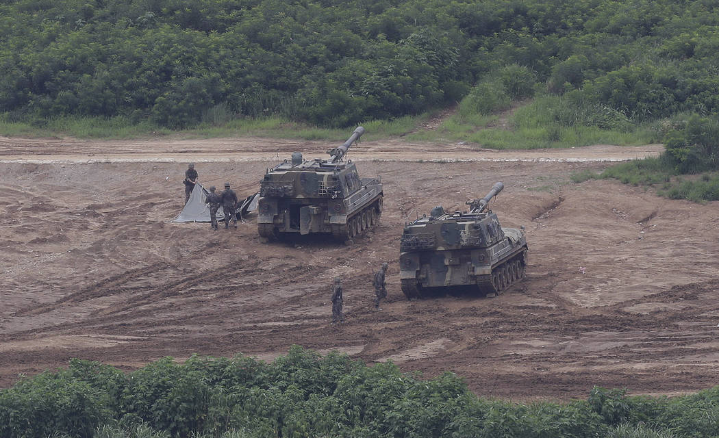 South Korean army soldiers prepare their military exercise in Paju, South Korea, near the border with North Korea, Sunday, July 30, 2017. The United States flew two supersonic bombers over the Kor ...
