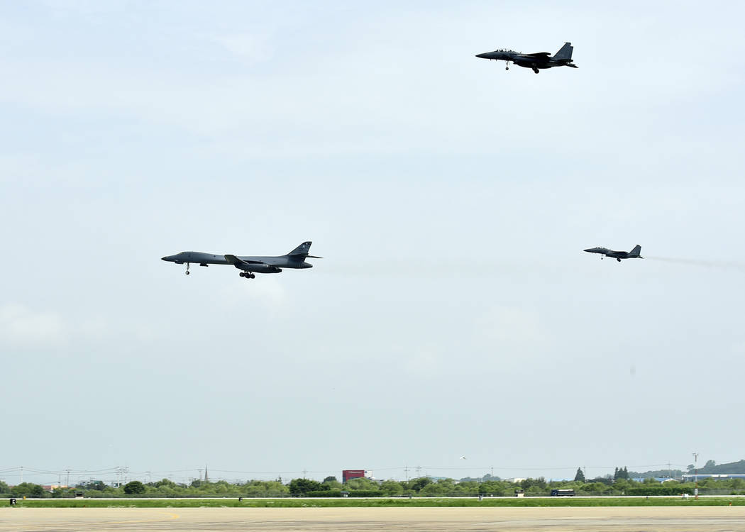 A U.S. Air Force B-1B bomber, left, flies with South Korean F-15K fighter jets over Osan Air Base in Pyeongtaek, South Korea, Sunday, July 30, 2017. The United States flew two supersonic bombers o ...