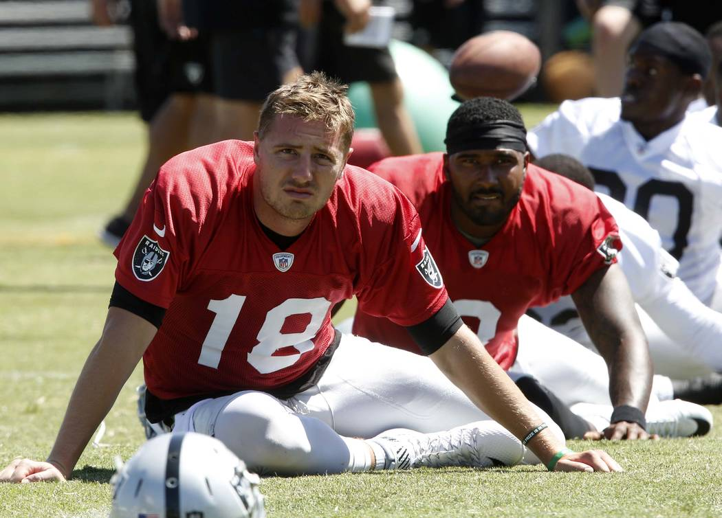 The Oakland Raiders backup quarterbacks Connor Cook, left, and Ej Manuel stretch during the second day of teams practice at Raiders Napa Valley training complex in Napa., Calif., on Sunday, July 3 ...