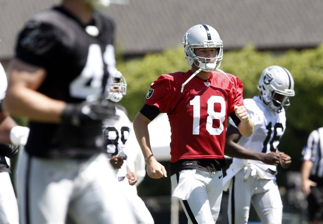 The Oakland Raiders defensive linebacker Brady Sheldon (41), backup quarterback Connor Cook (18), and wide receiver Johnny Holton (16) run off the field during the second day of teams practice at  ...